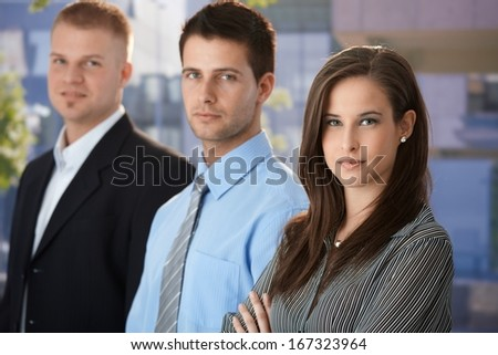 Outdoor portrait of confident young businesspeople , looking at camera.