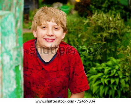 Outdoor portrait of cute little boy smiling - stock photo