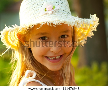 Outdoor portrait of cute teenage girl on sunny summer day. - stock photo
