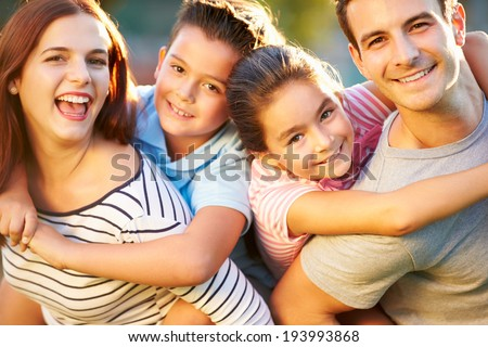 Outdoor Portrait Of Family Having Fun In Park - stock photo