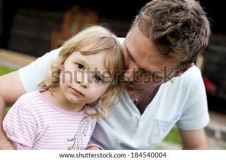 Outdoor portrait of father with his little daughter - stock photo