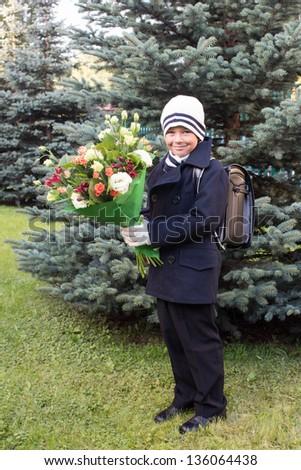 Outdoor portrait of first-grader boy - stock photo