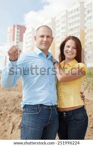 Outdoor portrait of   happy family against real estate - stock photo