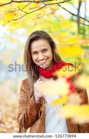 Outdoor portrait of happy girl at autumn park - stock photo