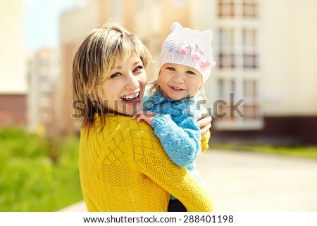 outdoor portrait of mother and daughter. child and mom walk in the summer - stock photo