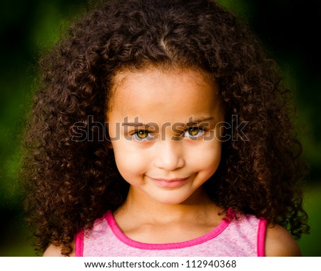 Outdoor portrait of pretty mixed race African-American girl - stock photo