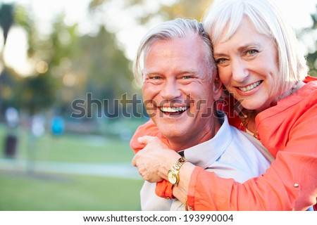 Outdoor Portrait Of Romantic Mature Couple In Park - stock photo
