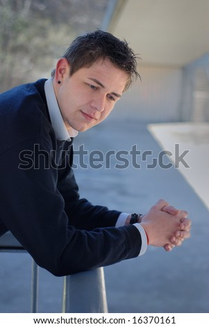 outdoor portrait of smart and young businessman