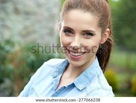 Outdoor portrait of smiling beautiful woman
