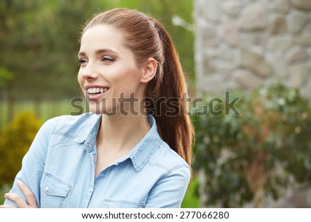 Outdoor portrait of smiling beautiful woman - stock photo