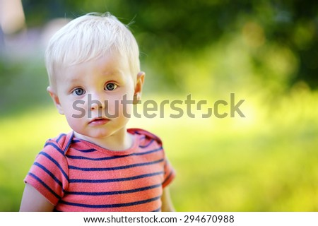 Outdoor portrait of toddler boy - stock photo