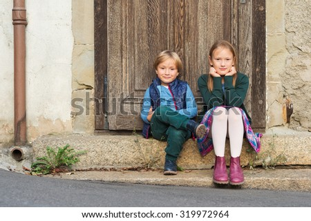 Outdoor portrait of two adorable kids - stock photo