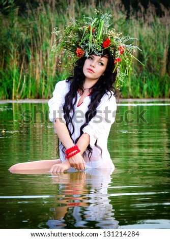 Outdoor portrait of woman in wreath - stock photo