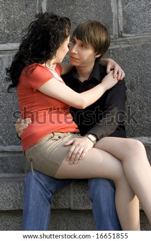 outdoor portrait of young attractive couple together