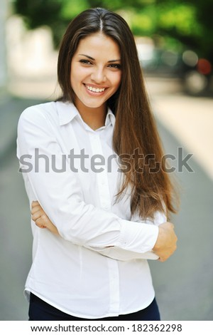 Outdoor portrait of young attractive woman  - stock photo