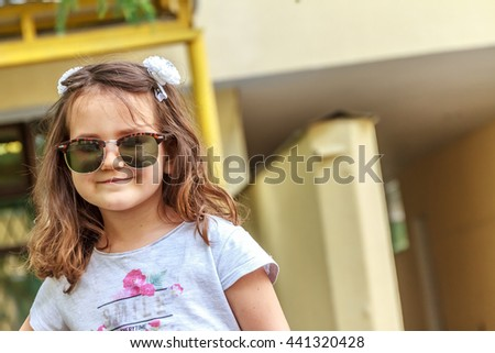 outdoor portrait of young child girl on natural background - stock photo
