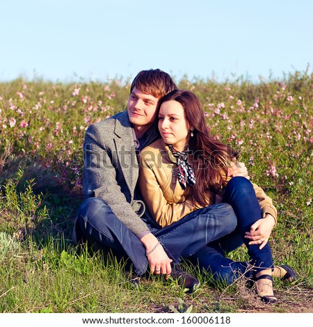Outdoor Portrait of young couple against the sky - stock photo