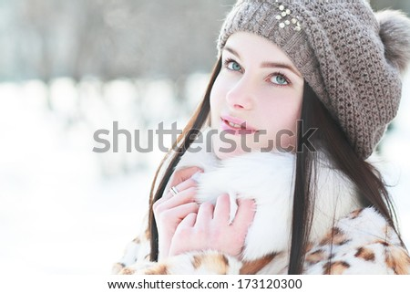 Outdoor portrait of young pretty beautiful woman in cold sunny winter weather in park. Sensual brunette posing and having fun - stock photo