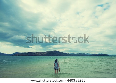 Outdoor portrait of young pretty woman posing near the sea alone and waiting for her sailor man husband  - stock photo