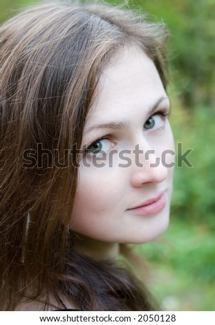 Outdoor portrait of young woman in the autumn park - stock photo