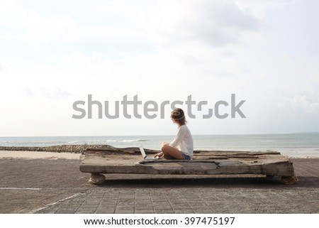Outdoor portrait of young writer/blogger/freelancer/student with laptop