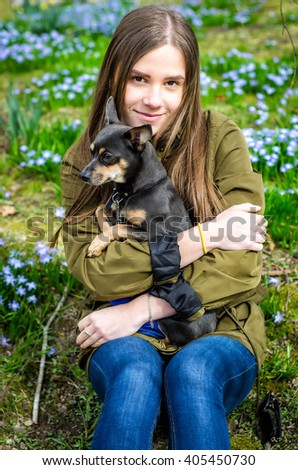 Outdoor portrait with small dog - stock photo