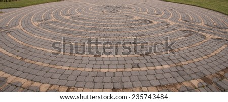 Outdoor prayer labyrinth made of two-toned bricks - stock photo