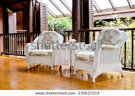 Outdoor rest area with white nice armchair sofa, - stock photo