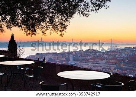 Outdoor restaurant with fantastic view of Lisbon at sunset. Portugal