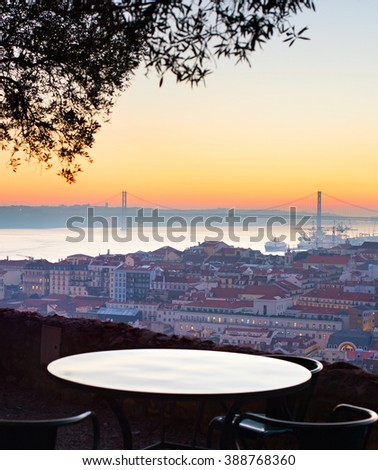 Outdoor restaurant with overview of Lisbon at sunset. Portugal - stock photo