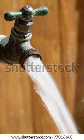 Outdoor Running Water Spigot - stock photo