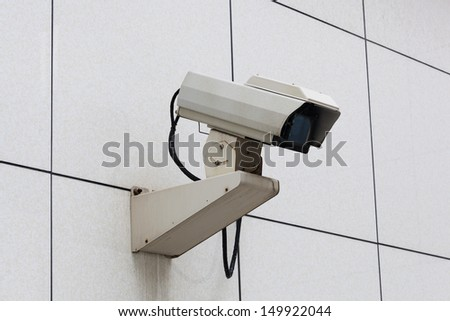 Outdoor Security Camera in a white wall