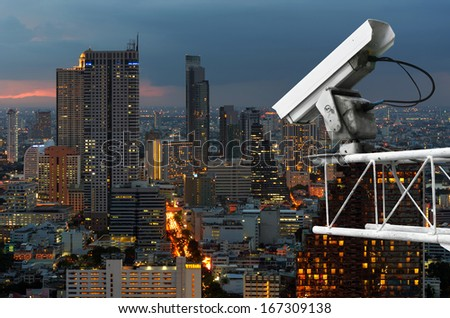 Outdoor security cameras on high towers. Set against the high corner of Bangkok. - stock photo