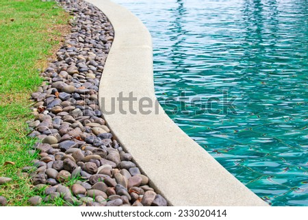 outdoor shallow water swimming pool - stock photo