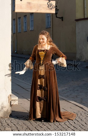 Outdoor shot of a beautiful lady in medieval dress - stock photo