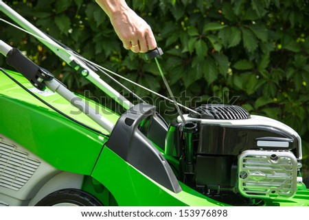 Outdoor shot of green lawnmower.  - stock photo