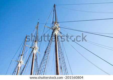 Outdoor shot of nautical vessel masts in a recreational boat.