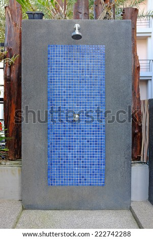 outdoor shower at swimming pool - stock photo