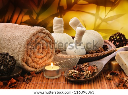 Outdoor spa massage setting at sunset with candlelight