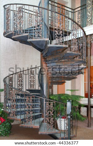 Outdoor spiral staircase - stock photo