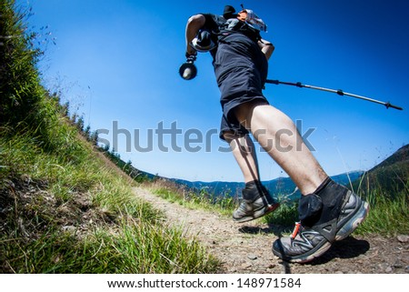 Outdoor sport activity - trail running in the countryside - stock photo