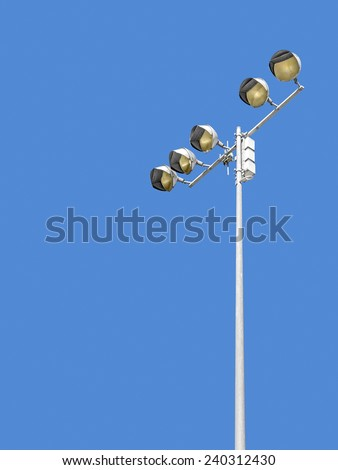 Outdoor stadium lights against daytime blue sky. Single row of bulbs on tall metal pole. Room for text, copy space. Vertical composition.  - stock photo