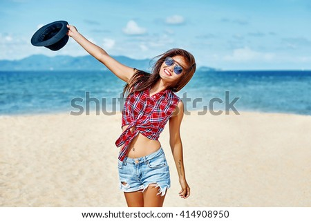 Outdoor summer portrait of young pretty asian woman having fun at tropical beach, enjoying freedom  - stock photo