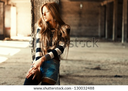 Outdoor summer portrait of young pretty cute blonde girl. Beautiful woman posing in spring. - stock photo