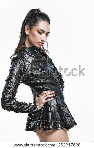 Outdoor summer portrait of young pretty cute brunette girl. Beautiful  woman wearing leather jacket. Fashion photo.