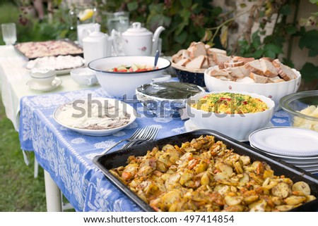 Outdoor summer wedding party event catering banquet lunch appetizer bread food meal elegant table setting