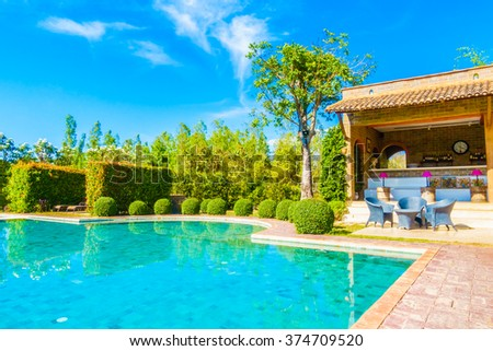 Outdoor swimming pool with beautiful landscape background - stock photo