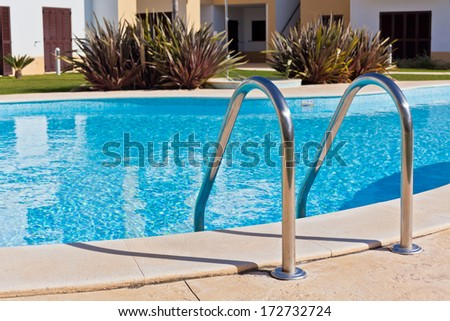 Outdoor Swimming pool with Ladder. Horizontal shot - stock photo