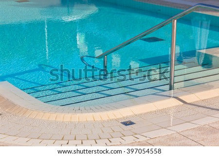 Outdoor Swimming pool with staircase. Horizontal shot - stock photo