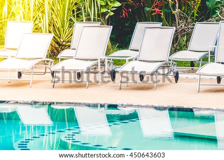 Outdoor Swimming Pool With Umbrella And Chair In Hotel Resort   Vintage  Light Filter And Sunflare